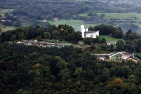 Aerial photo of Ronchamp today. Photographer: Iwan Baan (Bauwelt)