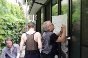 Joseph Kosuth reviewing plans for the art installations at the Dog House. Photo by pm cook.