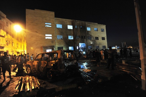 People gather to look at the damage caused by explosions at judicial buildings in Benghazi July 28, 2013. Photo by Esam Al-Fetori.